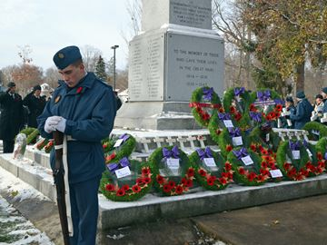 Cadet Maxim Brisette stands at attention while wreaths are laid at the Midland cenotaph.