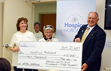 JoAnn Warren, Fund Development Manager (left) and Anne Murphy, Hospice Huronia Board Chair, accept a cheque from Tiny Township Mayor George Cornell. Hospice Huronia launched a capital fundraising campaign on Sept. 28.