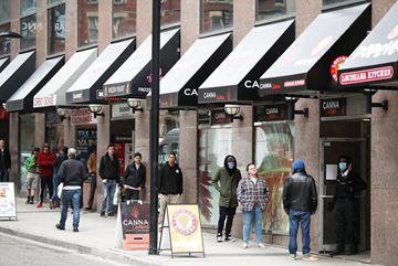 Customers lined up on Yonge Street last weekend just before pot shops were ordered to close. Licenced retailers will now be allowed to deliver and offer curbside pick-up.