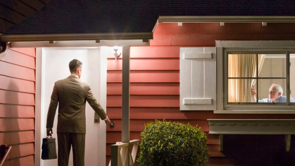 Salesman Ringing Doorbell of House