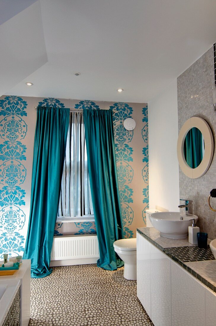 https www living4media com images 11313786 bathroom with floor length curtains on window floral wallpaper and washstand with countertop basins to one