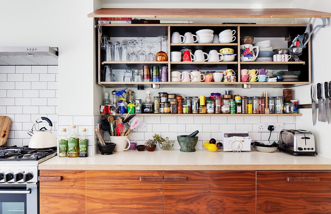 https www living4media com images 11341350 kitchen wall cabinet with open lift up door above spice rack and base units of recycled wood