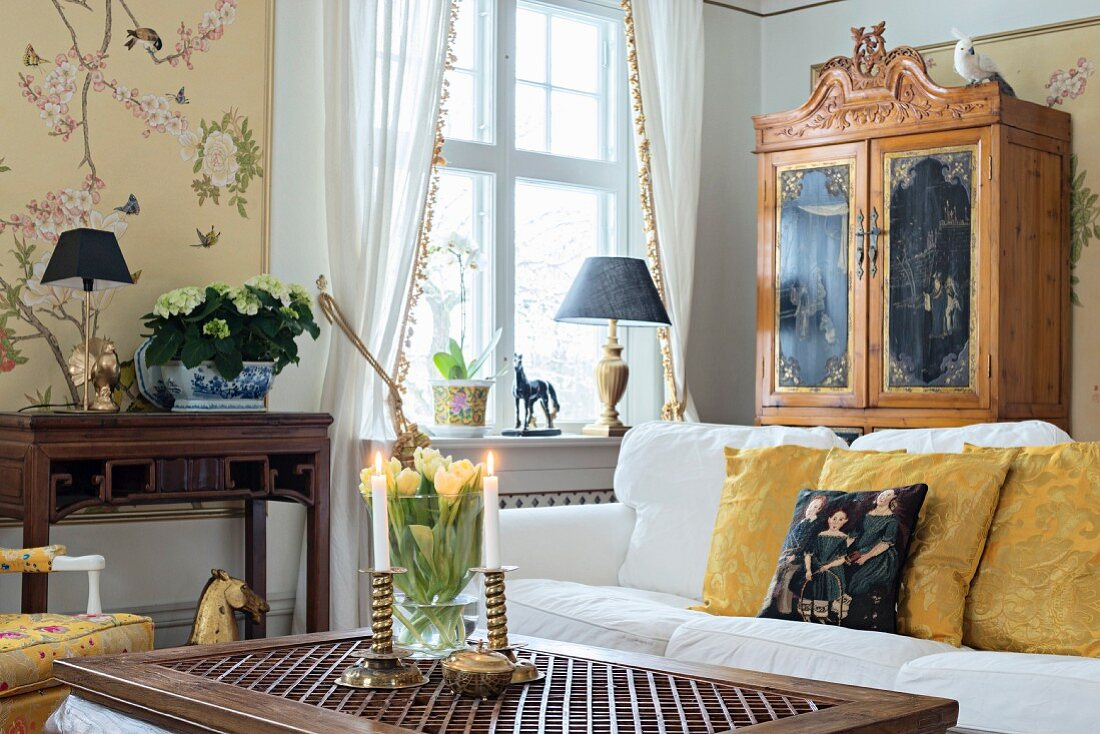http www living4media com images 11399640 coffee table white sofa antique writing desk and cupboard next to window with draped white curtains