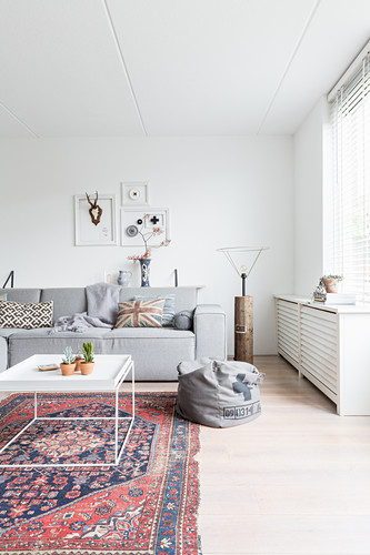 Old Rug And Modern Grey Sofa In White Buy Image 12355480 Living4media