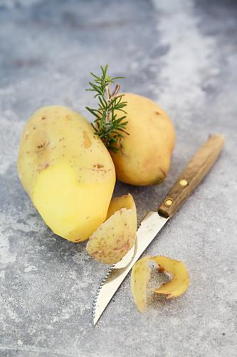 Peel potatoes and rosemary