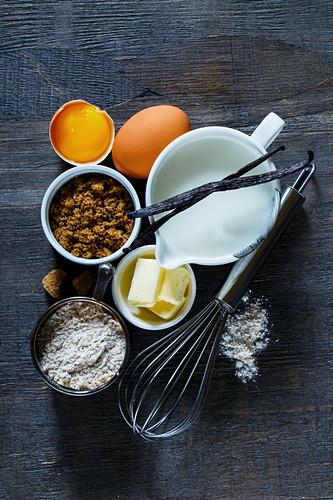 Still life with baking ingredients and utensils (top view)