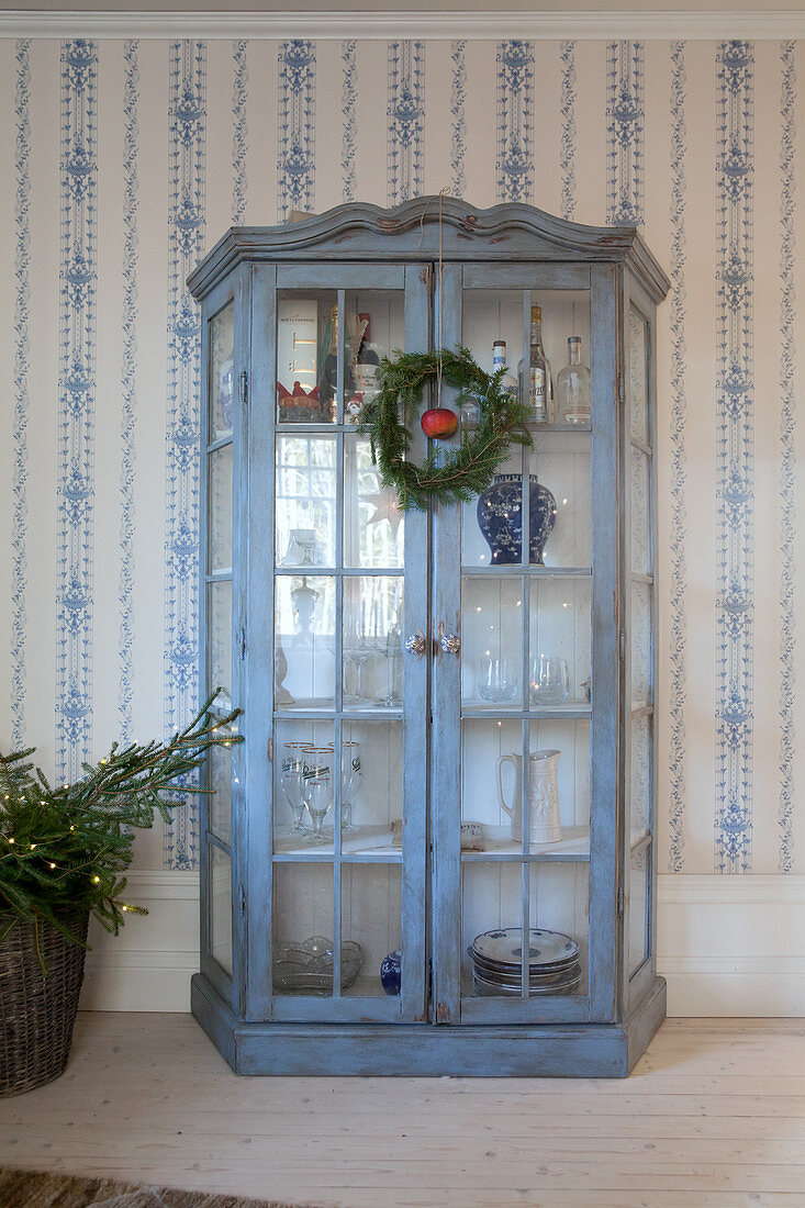It has small light bulbs that'll illuminate the room with warmth and calmness. Blue Shabby Chic Display Case Against Buy Image 12344705 Living4media