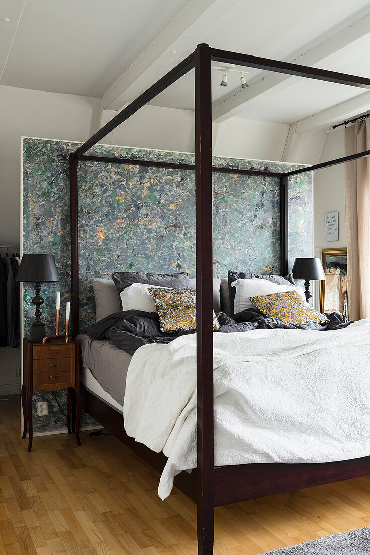 https www living4media com images 12622833 four poster bed with dark wooden frame against partition wall