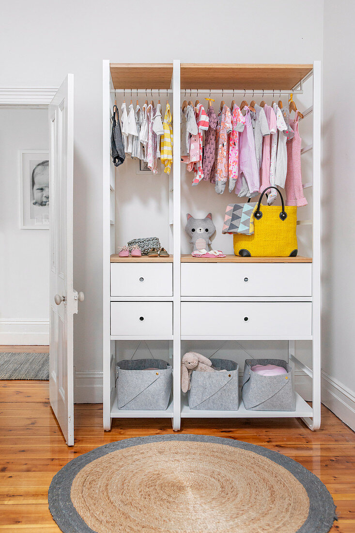 https www living4media com images 12667253 white open wardrobe with baby clothes in children s room