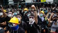 Kampf für die Zukunft: In Hongkong kommt es zu Zusammenstößen von Demonstranten und Polizei.