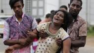 Trauernde Angehörige nach den Anschlägen in Colombo