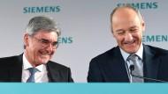 Noch-Chef Joe Kaeser und sein designierter Nachfolger Roland Busch (r.)