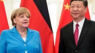 Bundeskanzlerin Angela Merkel (CDU) und der chinesische Präsident Xi Jinping