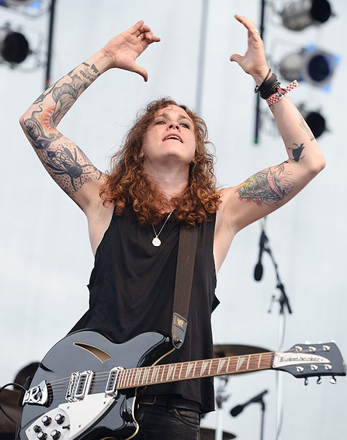 Against Me! front woman Laura Jane Grace claps along to her bands anthemic punk tunes