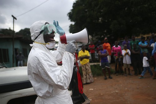 Aid workers stage an Ebola awareness event in Monrovia, Liberia.