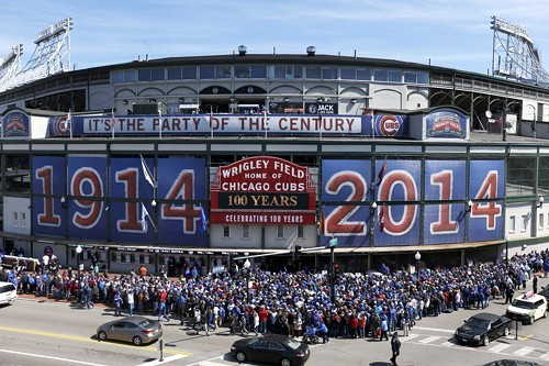 Fans outside Wrigley Field yesterday before the inevitable