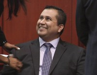 George Zimmerman smiling after hearing a not-guilty verdict
