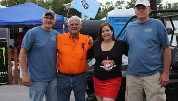 Mike and Amy Mills (center) pose with friends at Praise the Lard.