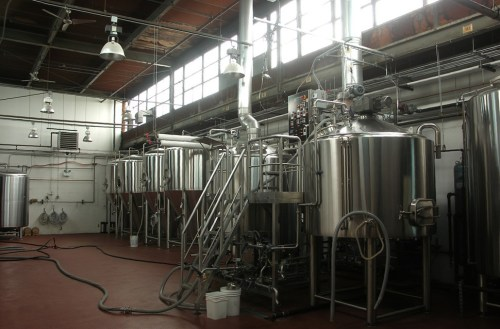 Nothing like a little natural light to show off your heavy stainless--in this case, a 20-barrel brewhouse and four 40-barrel fermenters. Thats the bright tank to the far left.