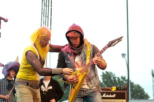 Peelander Yellow shows an audience member how to rock
