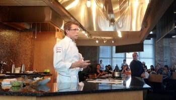 Rick Bayless answers questions after his presentation; Peter Sagal moderates