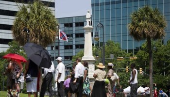 The Confederate flag still flew outside the South Carolina Statehouse as state senator Clementa Pinckneys funeral procession arrived.