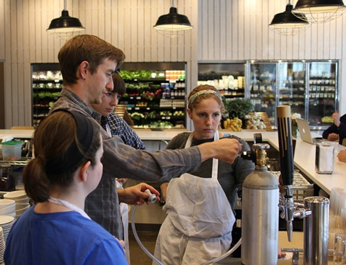 Abra Berens and the Stock team learning how to use the kombucha tap