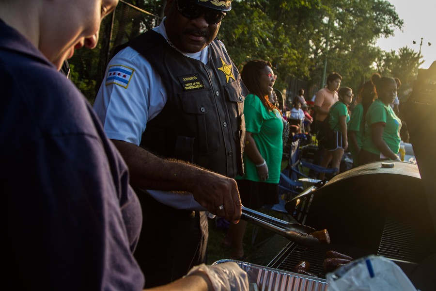 Chicago police superintendent Eddie Johnson mans the grill during a National Night Out barbecue in August. The event aims to create stronger police-community bonds. - MARIA CARDONA