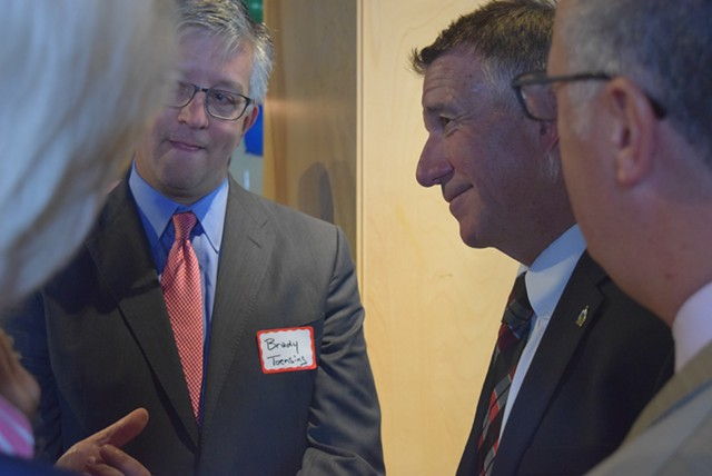 Vermont Republican Party vice chair Brady Toensing (left) and Gov. Phil Scott chatting with attendees - TERRI HALLENBECK