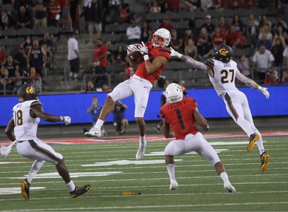Shawn Poindexter snags an onside kick attempt in the waning seconds of Arizona's 24-17 win over Cal on Saturday, Oct. 6. - CHRISTOPHER BOAN
