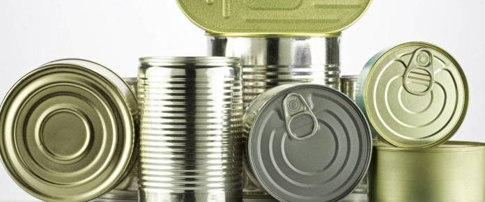 lots of cans against white background