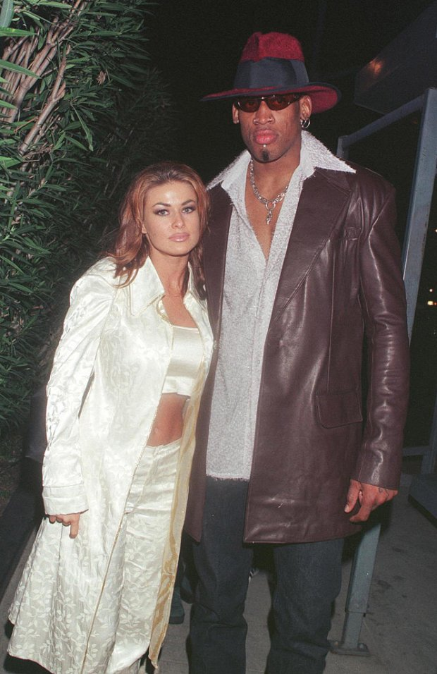 "Carmen Electra and Dennis Rodman were married in Las Vegas in November 1998 for only nine days before calling off the union. Carmen later compared her decision to marry Dennis in Vegas to ""getting a cheeseburger at a fast-food restaurant.""<br /><br />"