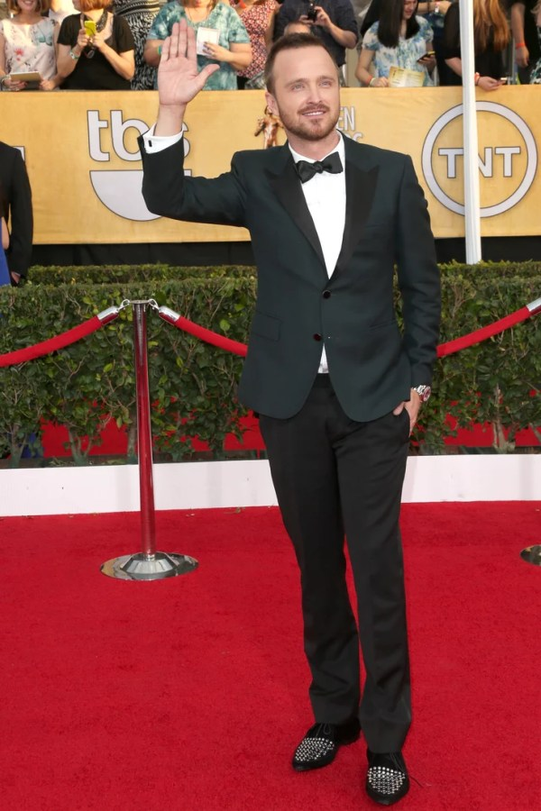 Aaron Paul waved to fans as he hit the red carpet ...
