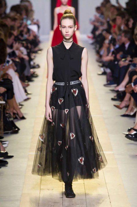 The original skirt had fewer layers of tulle, but was shown with the same blouse on the Spring 2017 runway.
