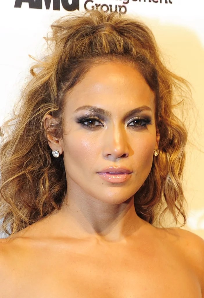 A Half Up Half Down Updo With Messy Waves Jennifer