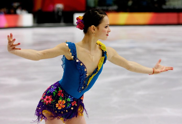 TURIN, ITALY - FEBRUARY 21:  Sasha Cohen of the United States performs during the women's Short Program of the figure skating during Day 11 of the Turin 2006 Winter Olympic Games on February 21, 2006 at Palavela in Turin, Italy.  (Photo by Brian Bahr/Getty Images)
