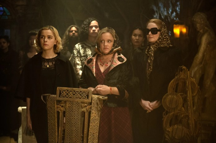 CHILLING ADVENTURES OF SABRINA, (left to right): Ross Lynch, Kiernan Shipka in 'Chapter Two: The Dark Baptism', (Season 1, Episode 102), aired October 26, 2018). ph: Diyah Pera / Netflix / courtesy Everett Collection