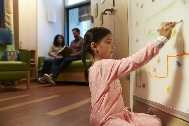 Patient rooms in the new building offer creative outlets for young artists.