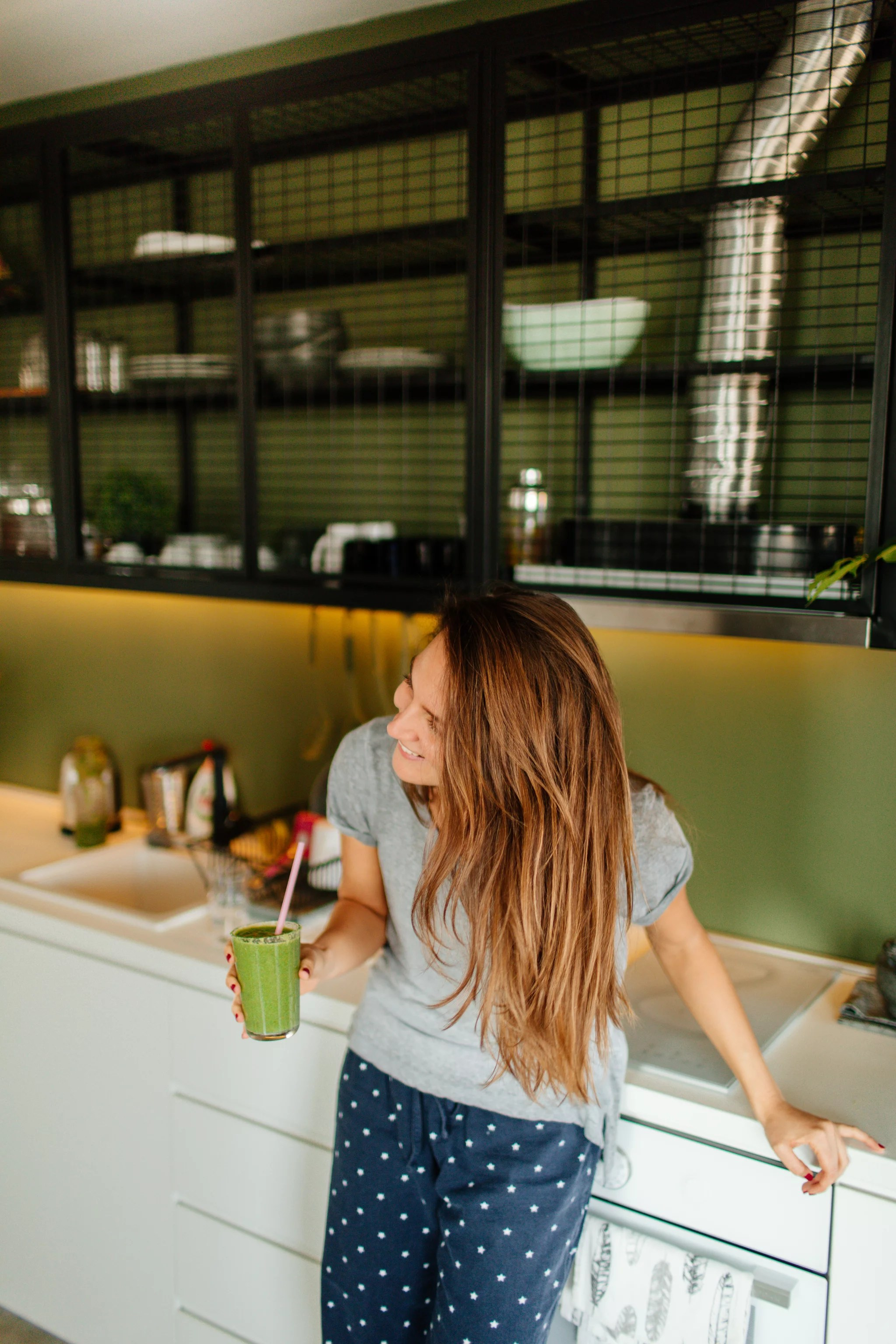 Photo of a young smiling woman having healthy breakfast in the morning