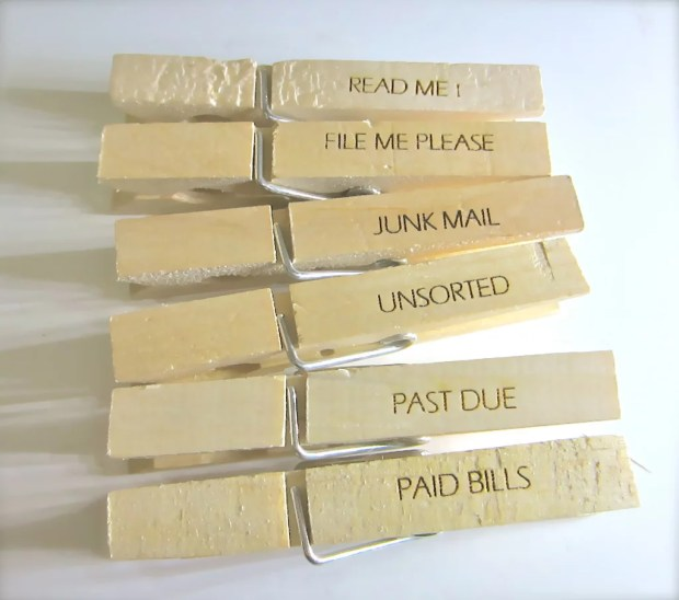 Decor in the Workplace Office Space Organized Desk Past Due Paid Bills Paper Clips Clothespins