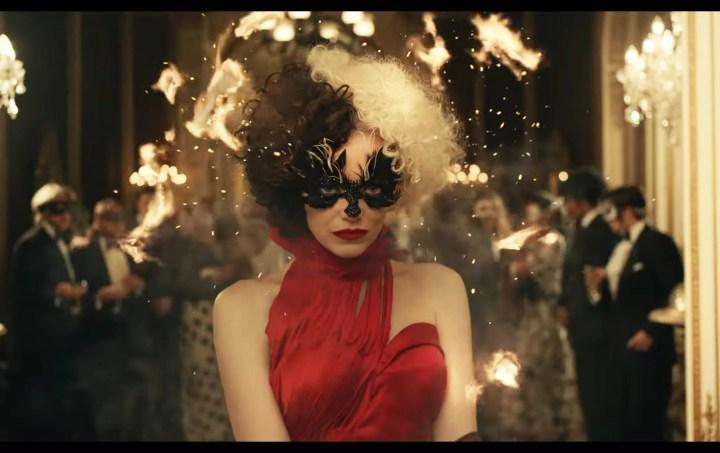 Emma Stone's Red Dress in Disney's Cruella Trailer   Emma Stone Plays  Cruella de Vil, an Aspiring Fashion Designer With Punk-Rock Costumes    POPSUGAR Fashion Photo 2