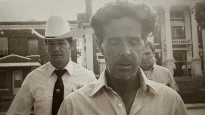 The Confession Killer  Henry Lee Lucas (center) walking in front of Ranger Phil Ryan (left)