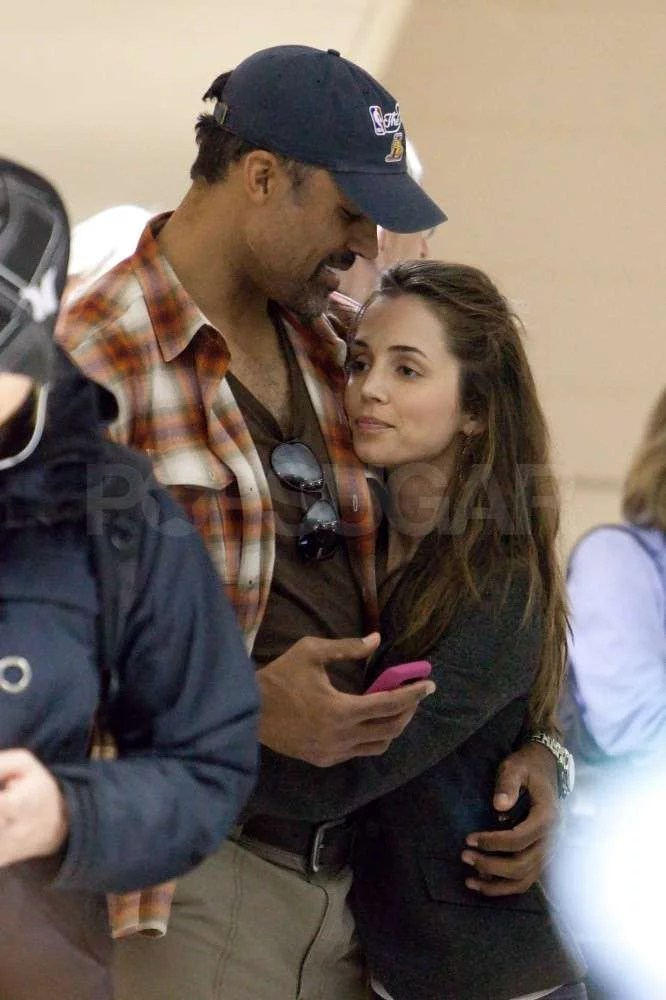 Pictures Of Rick Fox And Eliza Dushku At LAX During The