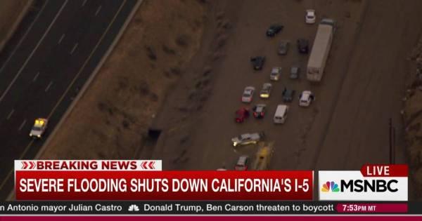 Storm blocks California freeway with mud