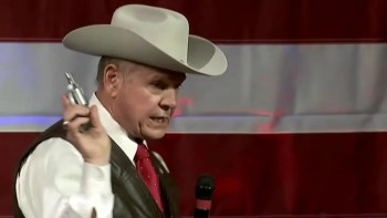 Roy Moore with gun