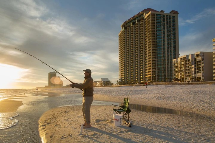 Image: The Phoenix West II condominium building, right, is one of dozens of buildings on the Gulf Coast beach in Orange Beach, Ala., that was moved from the highest-risk flood zone. Now insurance is optional for the owners of Phoenix West condos.
