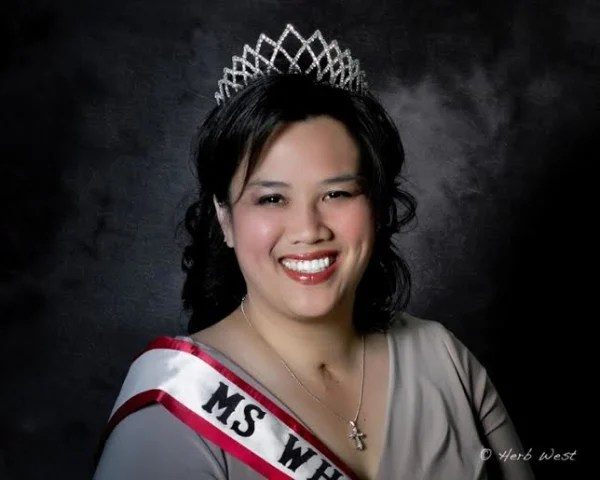Image: Theresa de Vera poses for a head shot after being crowned Ms. Wheelchair.