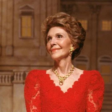 Image: Nancy Reagan, decked out in red lace dress & gold