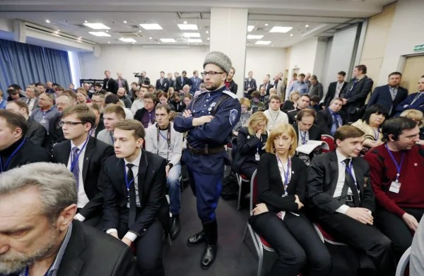 Image: Delegates listen to speeches during the 'International Russian Conservative Forum' in St. Petersburg