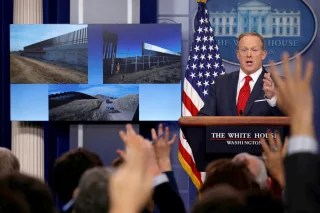 Image: Spicer discusses the building of a proposed border wall with Mexico during his daily briefing at the White House in Washington